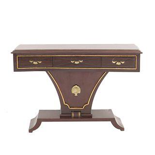 Mesa consola. SXX. Elaborada en madera con aplicaciones de bronce dorado. Cubierta  rectangular y 3 cajones con tiradores de metal.