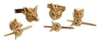 Seven Piece 14 Karat Tuxedo Set, to include cufflinks, there buttons, along with two tie tacs, all having fox heads with red eyes, 27.2 grams.