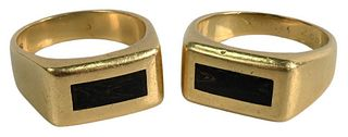 Two 18 Karat Gold Rings, both having center wooden insets, total weight 31.3 grams, sizes 11 1/2 inches and 12 1/2 inches.