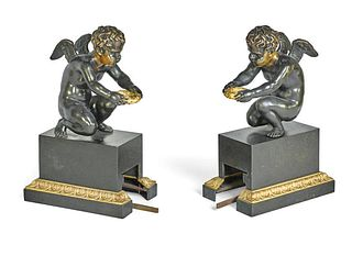 A PAIR OF PATINATED & GILT BRONZE FIGURAL FIRE FENDER