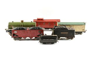 A GROUP OF SIX LIONEL PASSENGER, COAL, OIL, AND REFRIGERATOR CARS, PRE AND POST WAR,