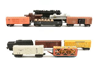 A GROUP OF ELEVEN LIONEL ELECTRIC TRAIN CARS, 736, 1004, 2671WX, 3464, 5576, 6454, 6457, 6462, 6465, 6472, 6656,