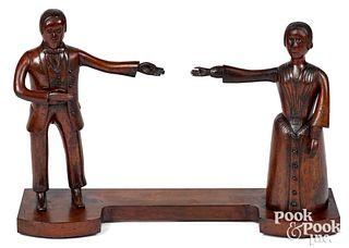 Carved mahogany folk art group