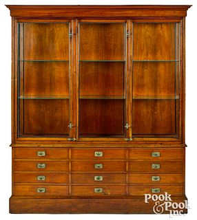 Large mahogany campaign style display cabinet