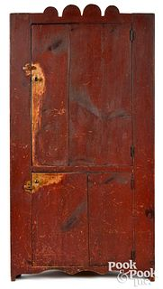 New England painted pine one-piece corner cupboard