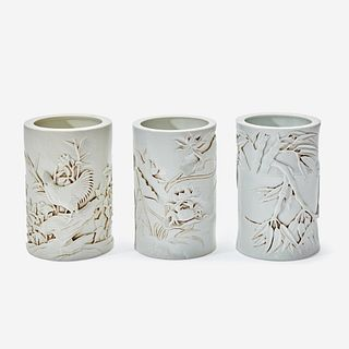 Three Chinese molded and carved porcelain brushpots 瓷塑雕刻笔筒一组三件 Mark of Wang Bingrong 王炳荣款