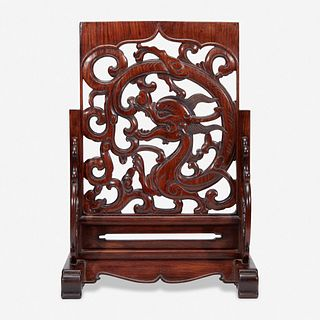 """A Chinese carved and pierced huanghuali """"dragon"""" panel, in later hardwood stand 黄花梨镂雕龙纹木板 后配底座 The panel late Ming/Qing dynasty 木板为明或清"""