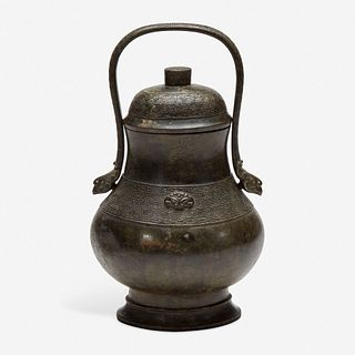 A Chinese archaistic patinated bronze covered wine vessel, you 倣古风格卣 late Ming/Qing dynasty 明末或清初
