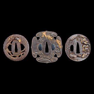 A group of three Japanese gold-inlaid iron tsuba, one signed 日本嵌金刀镡一组三件 一件带签字 Edo to early Meiji period 江户至明治