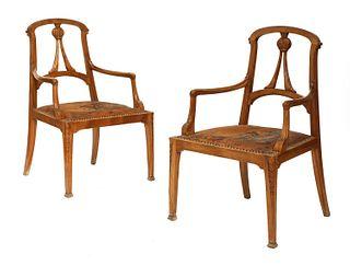 A pair of Art Nouveau walnut armchairs,