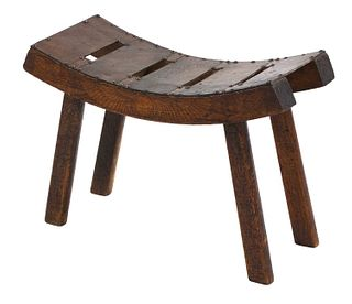 An Arts and Crafts 'Egyptian' pine stool,