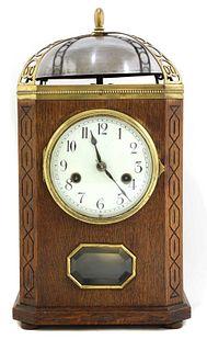An oak and brass-mounted mantel clock,