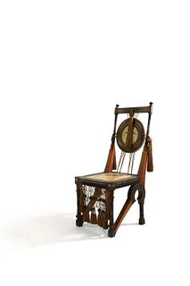 A walnut and copper side chair,
