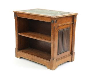 An oak Gothic Revival double-sided open bookcase,
