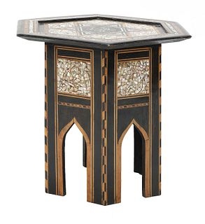 An ebonised Damascene coffee table,
