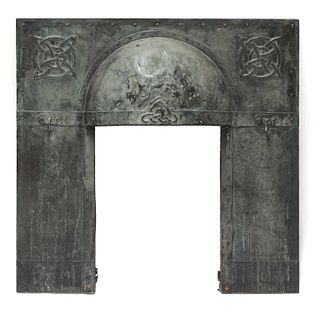 An Arts and Crafts verdigris patinated fireplace insert,