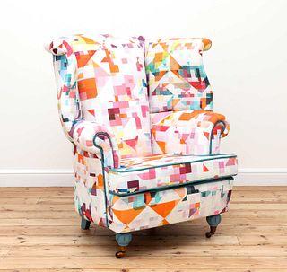A wingback armchair,