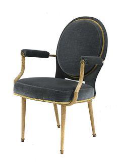 An armchair,