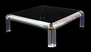 A Lucite coffee table,
