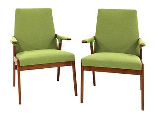 A pair of teak armchairs,