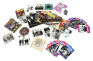 A collection of The Beatles vinyl records and ephemera,