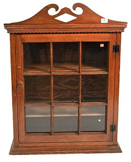 Primitive Cabinet  having broken arch top over one door with recessed panel side height 36 1/2 inches, top 27 3/4 inches