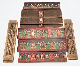Two Tibetan Books each having carved wood covers mounted with metal seated buddha figures hand written and painted interior