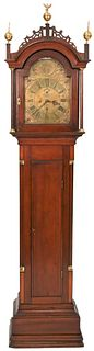 Walter H. Durfee Tall Case Grandfather Clockhaving shaped crest and brass finials, single door opening to brass dial, inlaid mahogany case with flute