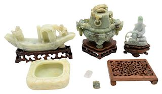 Six Carved Chinese Jade, Jadeite, and Stone Items to include square jade bowl on stand, covered urn having foo dog head handles, jadeite seated figure