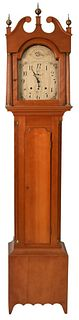 Federal Cherry Tall Clock with Tombstone Dial having painted wooden dial and wood works case having fluted columns height 90 inches Provenance: Fifty