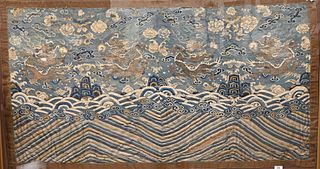 Chinese Embroidered Dragon Textile framed and made into a panel having five claw dragons amongst flaming clouds over crashing wave design 32 x 54 inch