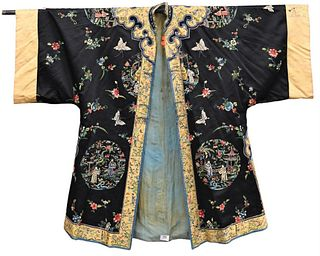 Chinese Silk Robe dark blue ground, having embroidered panels of figures in a courtyard, butterflies and wild flowers