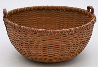 Nantucket Basket having two heart shaped handles total height 4 3/4 inches, diameter 9 inches  Provenance: Fifty Year Personal Collection of Clocks an