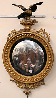 Gilt Convex Mirror having black top eagle over mirror with foliate bottom ornament height 39 inches, width 22 inches