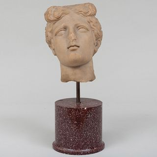 Carved Marble Bust of a Woman on a Porphyry Socle, After the Antique