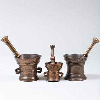 Group of Three Bronze Mortars and Three Bronze Pestles