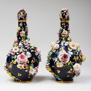 Pair of Paris Blue Ground Porcelain Flower Encrusted Vases and Covers