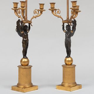 Pair of Empire Style Gilt and Patinated Bronze Three-Light Figural Candelabra