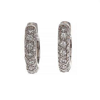 Pair of creole earrings in 18 kt white gold