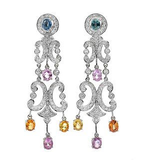 Pair of long earrings with movement in 18k white gold.