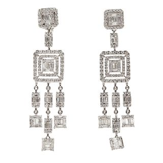 Pair of long earrings with movement made in 18kt white gold,