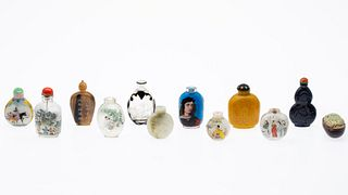 11 Chinese Snuff Bottles and a Carved Stone