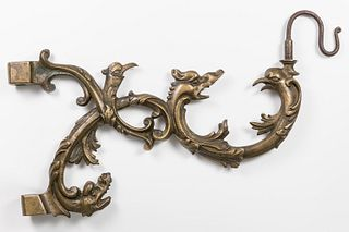 Arm with grotesques for wall lamp; Holland, XVII century. Bronze and iron.