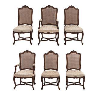 Juego de 4 sillas y 2 sillones. SXX Estilo Luis XV Elaborados en madera. Con respaldos de bejuco tejido y asientos en tapicería de tela