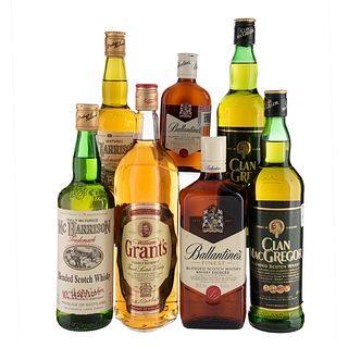 Lote de Whisky. Mc Harrison. William Grant's  En presentaciones de 1 Lt., 750 ml., 700 ml. y 200 ml. Total de piezas: 7.