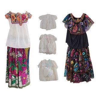 Lote de Vestidos, vestidos de infantes, blusas y faldas. SXX. Bordados a mano con motivos florales.