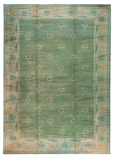 ANTIQUE IRISH DONEGAL CARPET, DESIGNED BY C. F. A. VOYSEY. 22 ft 1 in x 15 ft 3 in (6.73m x 4.64m).