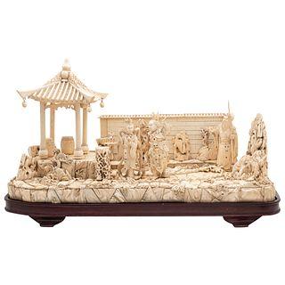 PUEBLO CON PAGODA CHINA, SIGLO XX En marfil tallado y entintado Detalles de conservación  60 x 30 cm