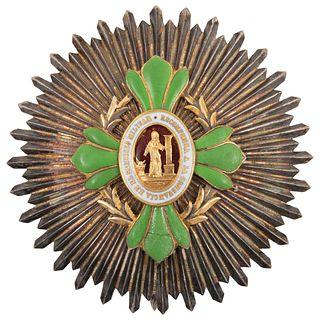 RECOMPENSA A LA CONSTANCIA EN EL SERVICIO MILITAR MÉXICO, 1841 Decoración de cuatro tréboles en esmalte verde 6.5 cm diámetro