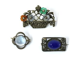 Three silver brooches,
